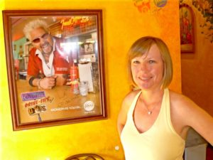 Anna in front of DDD Poster with Guy Fieri