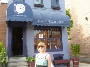 Anna in front of Blue Moon Cafe